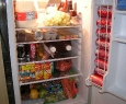 and an over full refrigerator