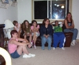 Arlene sitting on the floor, I do not know a few of the children, but there is LeghAnn, Lynn, Vincent and Sue.  So many children were there to greet Derrick